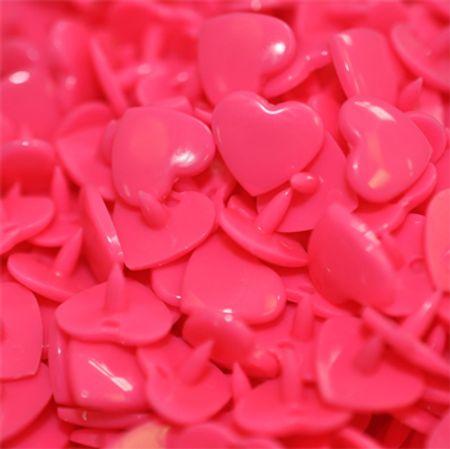 Sachet de 25 pressions résine coeurs - Rose fluo