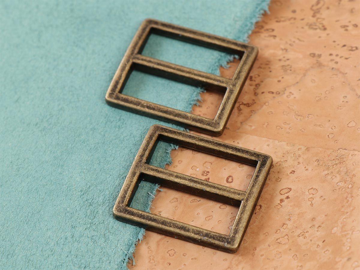 Set de 2 boucles coulissantes 28 x 25 mm laiton antique